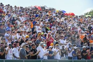 Fans cheer from the grandstands