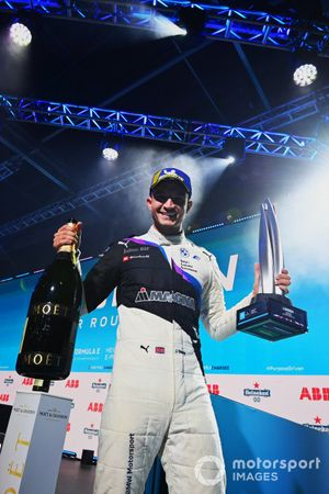 Jake Dennis, BMW I Andretti Motorsport, first position, with his trophy, Champagne