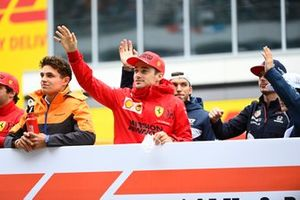 Lando Norris, McLaren, and Charles Leclerc, Ferrari, in the drivers parade