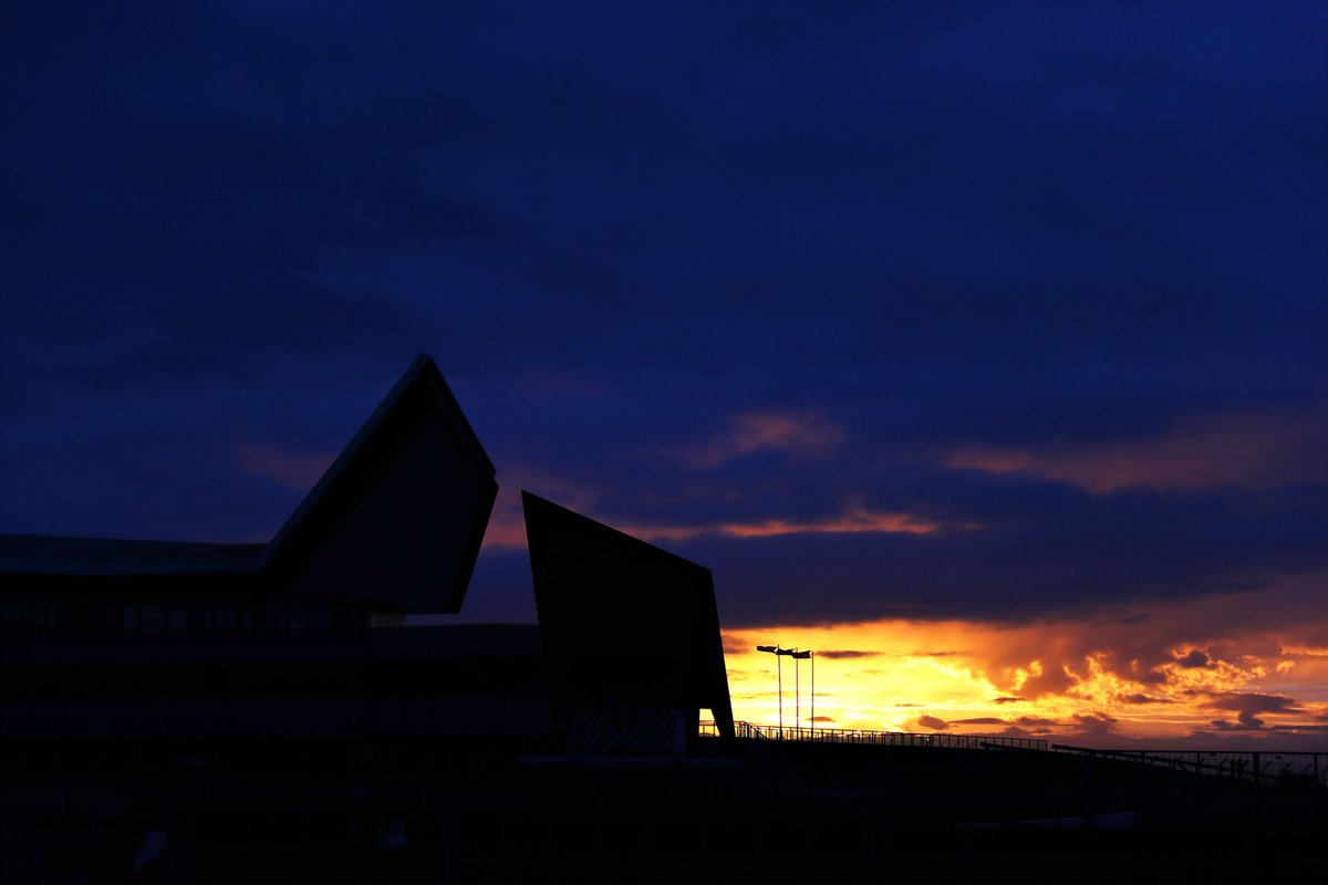The sun rises over the circuit