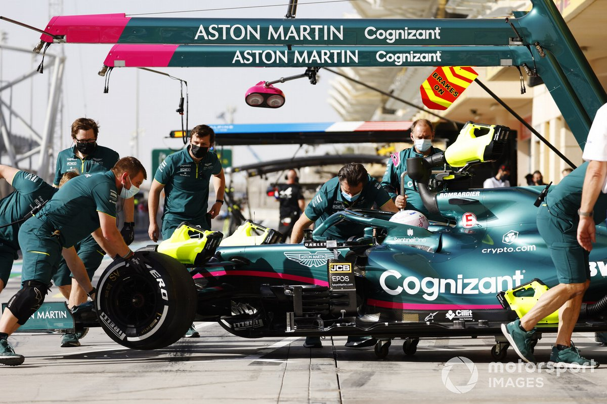 Sebastian Vettel, Aston Martin AMR21, is returned to the garage