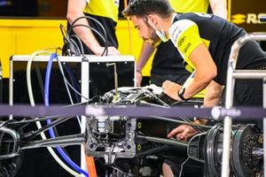 A Renault F1 mechanic at work in the garage