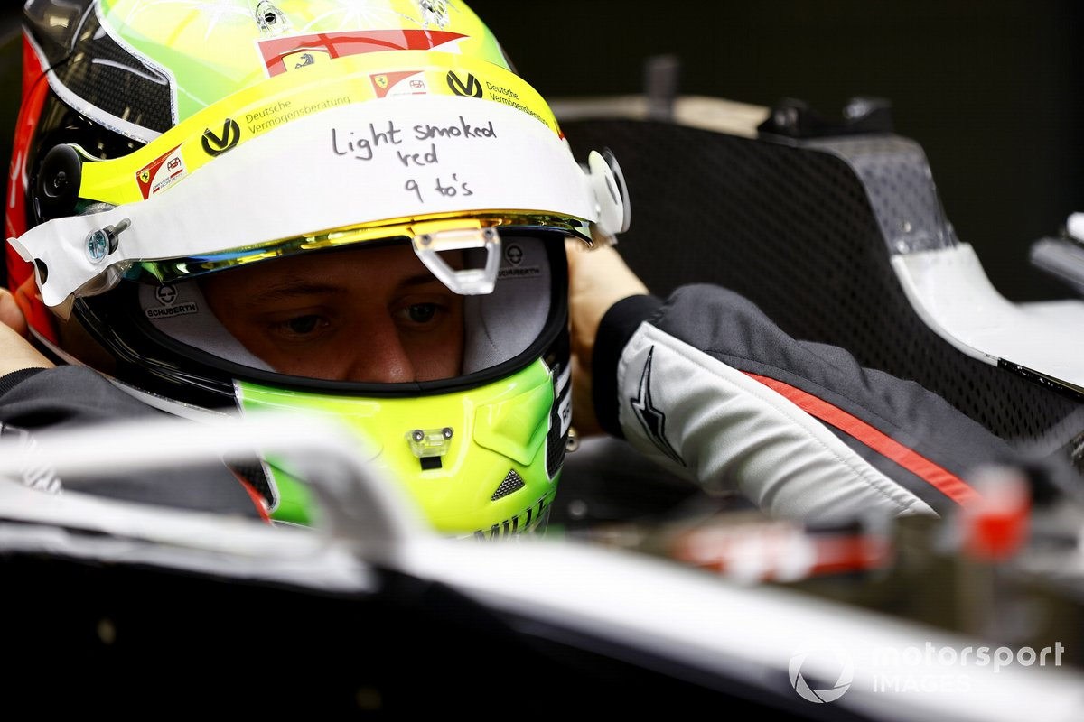 Mick Schumacher sits in his Haas VF-20 for his seat fitting.