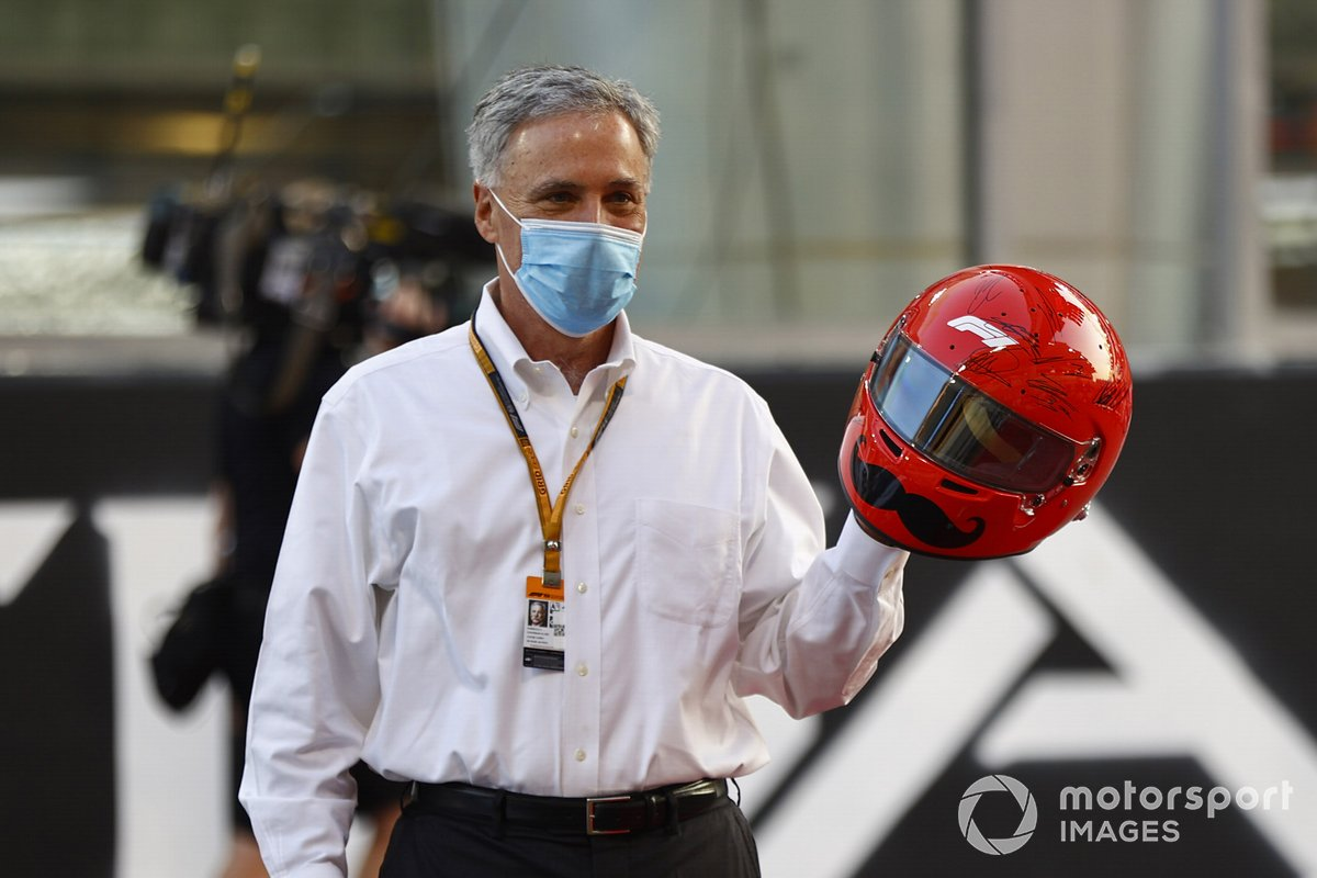 Chase Carey, Chairman, Formula 1, with his signed commemorative helmet on the grid