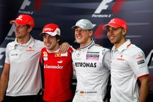 World Champions Jenson Button, McLaren MP4-25 Mercedes, Felipe Massa, Ferrari F10, Michael Schumacher, Mercedes GP W01 and Lewis Hamilton, McLaren MP4-25 Mercedes pose for a photo in the press conference