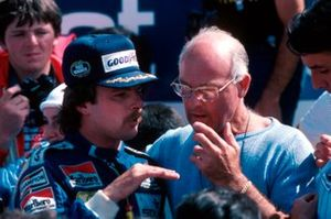 First time race winner Keke Rosberg Williams talks with BBC TV commentator Murray Walker