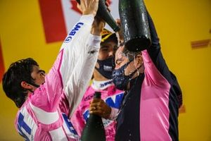 Lance Stroll, Racing Point, Race winner Sergio Perez, Racing Point and Andy Stevenson, Sporting Director, Racing Point celebrate on the podium with the champagne