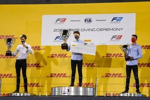 F3 Championship Winner Oscar Piastri, Prema Racing, 2nd place Theo Pourchaire, ART Grand Prix and 3rd position Logan Sargeant, Prema Racing celebrate on the podium with the trophy
