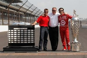 Chip Ganassi with Indy 500, Brickyard 400 and Daytona 500 trophies