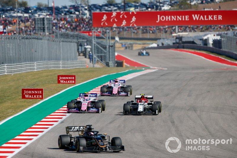 Romain Grosjean, Haas VF-19, leads Antonio Giovinazzi, Alfa Romeo Racing C38, Lance Stroll, Racing Point RP19, and Sergio Perez, Racing Point RP19