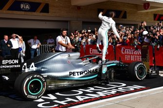 Lewis Hamilton, Mercedes AMG F1, 2nd position, climbs out of his car in Parc Ferme after securing his sixth world drivers championship title