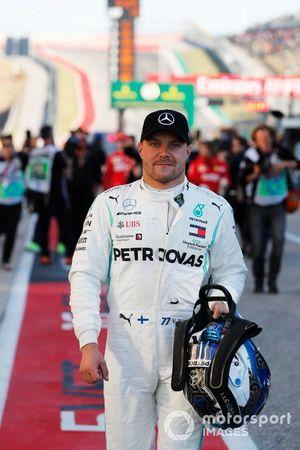 Valtteri Bottas, Mercedes AMG F1, celebrates after taking Pole Position