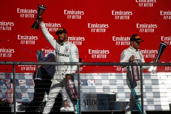 Lewis Hamilton, Mercedes AMG F1, 2nd position, and Valtteri Bottas, Mercedes AMG F1, 1st position, on the podium with their trophies