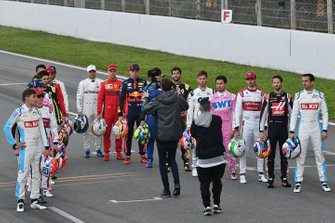 The drivers line up on the track