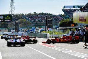 Sebastian Vettel, Ferrari SF90, joins the queue to leave the pit lane