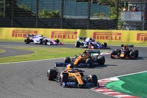 Carlos Sainz Jr., McLaren MCL34, leads Lando Norris, McLaren MCL34, Alex Albon, Red Bull RB15, Pierre Gasly, Toro Rosso STR14, and Lance Stroll, Racing Point RP19