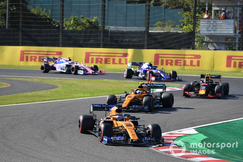 Carlos Sainz Jr., McLaren MCL34, leads Lando Norris, McLaren MCL34, Alex Albon, Red Bull RB15, Pierre Gasly, Toro Rosso STR14, and Lance Stroll, Racing Point RP19
