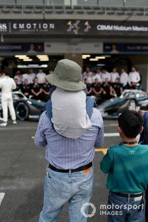 Fans watch the Mercedes Benz EQ team in the pitlane
