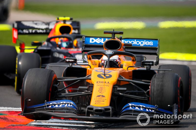 Carlos Sainz Jr., McLaren MCL34 and Alex Albon, Red Bull RB15