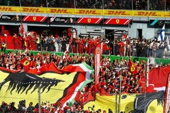 The crowd celebrates a win for Ferrari at home