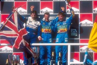 Podium: race winner Michael Schumacher, Benetton, second place Damon Hill, third place Jos Verstappen, Benetton