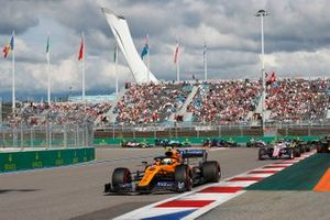 Lando Norris, McLaren MCL34, leads Sergio Perez, Racing Point RP19, Max Verstappen, Red Bull Racing RB15, Nico Hulkenberg, Renault F1 Team R.S. 19, as behind, Antonio Giovinazzi, Alfa Romeo Racing C38, Romain Grosjean, Haas F1 Team VF-19 and Daniel Ricciardo, Renault F1 Team R.S.19 collide