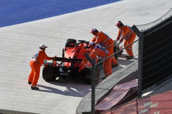 Marshals move the car of Sebastian Vettel, Ferrari SF90, off the circuit