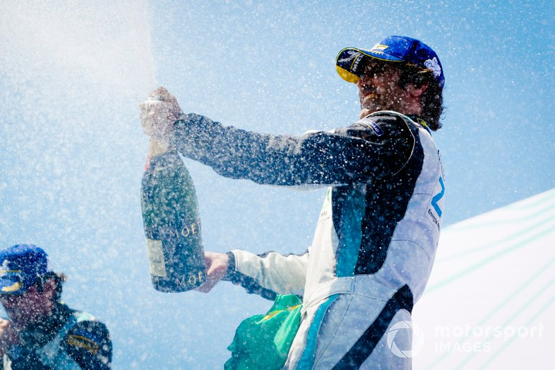 Race winner Sérgio Jimenez, Jaguar Brazil Racing celebrates with the champagne on the podium