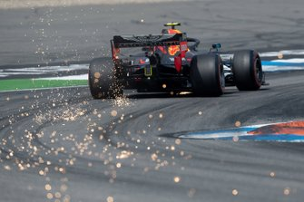 Sparks fly from the car of Pierre Gasly, Red Bull Racing RB15