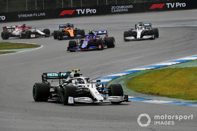Valtteri Bottas, Mercedes AMG W10, leads Alexander Albon, Toro Rosso STR14, and Lewis Hamilton, Mercedes AMG F1 W10