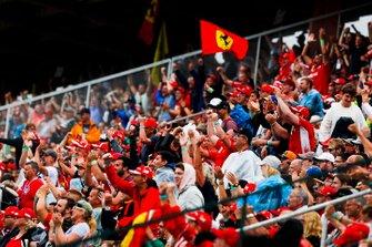 Fans cheer as Sebastian Vettel, Ferrari SF90, takes a position