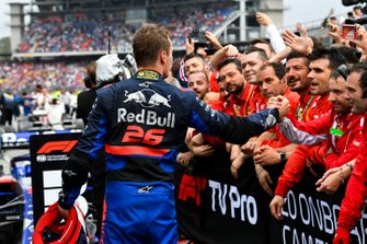 Daniil Kvyat, Toro Rosso, 3rd position, shows respect to the Ferrari team in Parc Ferme