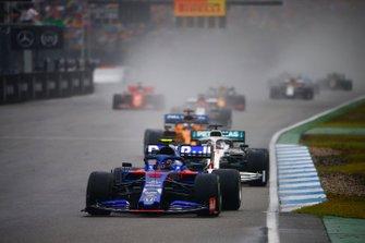 Alexander Albon, Toro Rosso STR14, leads Lewis Hamilton, Mercedes AMG F1 W10, and Carlos Sainz Jr., McLaren MCL34