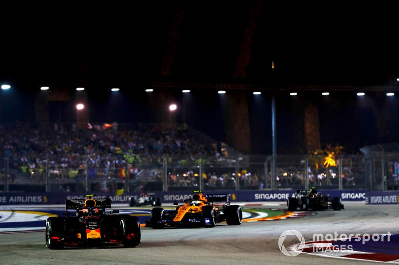 Alexander Albon, Red Bull Racing RB15, leads Lando Norris, McLaren MCL34, and Kevin Magnussen, Haas F1 Team VF-19