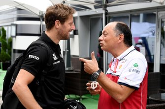 Romain Grosjean, Haas F1 Team speaks with Frederic Vasseur, Team Principal, Alfa Romeo Racing