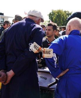 Mechanics listen to Dani Pedrosa after a practice session
