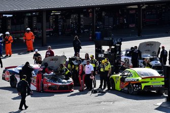 Christopher Bell, Joe Gibbs Racing, Toyota Supra Rheem, Brandon Jones, Joe Gibbs Racing, Toyota Supra Menards/Atlas, and Harrison Burton, Joe Gibbs Racing, Toyota Supra Dex Imaging in the garage area