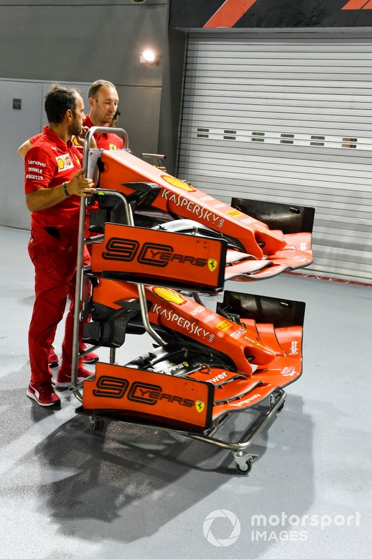 Front wing of Ferrari SF90 on a trolly being pushed by Ferrari mechanics