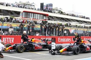 Max Verstappen, Red Bull Racing, 1st position, and Sergio Perez, Red Bull Racing, 3rd position, arrive in Parc Ferme