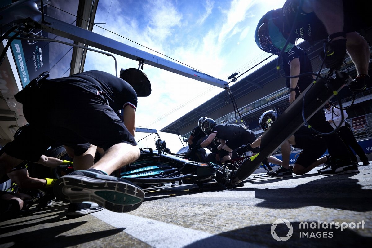 Mercedes mechanics during pit stop practice