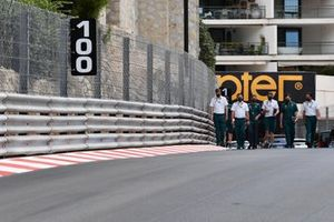 Sebastian Vettel, Aston Martin, walks the track with his team