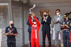 Carlos Sainz Jr., Ferrari, 2nd position, lifts his trophy