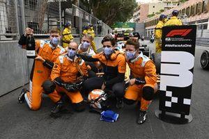 McLaren mechanics celebrate in Parc Ferme