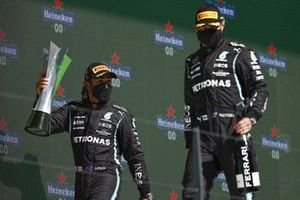 Lewis Hamilton, Mercedes, 1st position, with his trophy and Valtteri Bottas, Mercedes, 3rd position, on the podium
