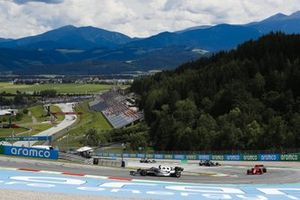 Yuki Tsunoda, AlphaTauri AT02, Carlos Sainz Jr., Ferrari SF21, and Sebastian Vettel, Aston Martin AMR21