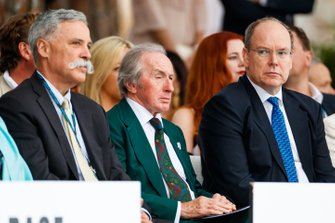Chase Carey, Chairman, Formula 1, three times world champion Sir Jackie Stewart and Prince Albert II at the Amber Lounge fashion show