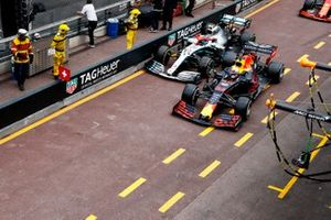 Valtteri Bottas, Mercedes AMG W10 and Max Verstappen, Red Bull Racing RB15 battle in the pit lane