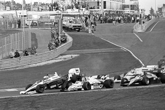 Ayrton Senna, Toleman TG184 flies into the air after hitting the rear of Keke Rosberg, Williams FW09B at the start of the race, triggering a multi-car collision