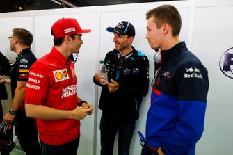 Charles Leclerc, Ferrari, talks with Robert Kubica, Williams Racing, and Daniil Kvyat, Toro Rosso