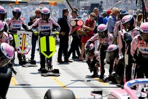 The Racing Point pit crew practice their stop procedures